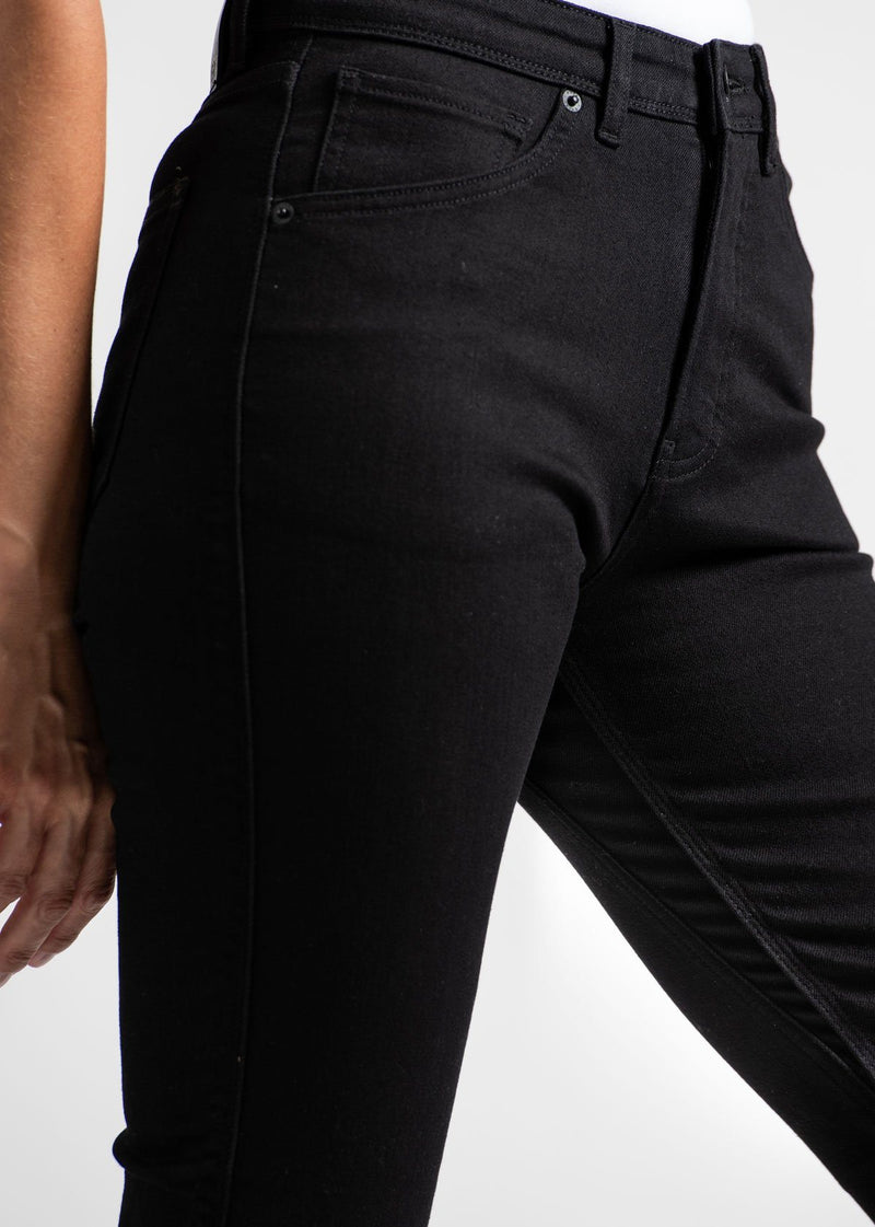 woman wearing high rise skinny fit black stretch jeans side detail