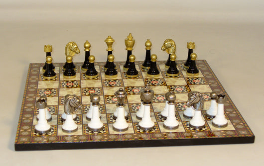 Black & White Metal and Wood chess pieces on Mosaic Board