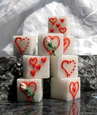 Decorated sugar cubes featuring different heart designs