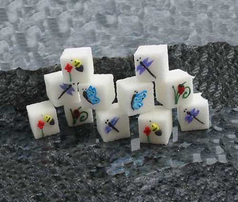 Decorated sugar cubes with butterflies, dragonflies, bees, and ladybugs