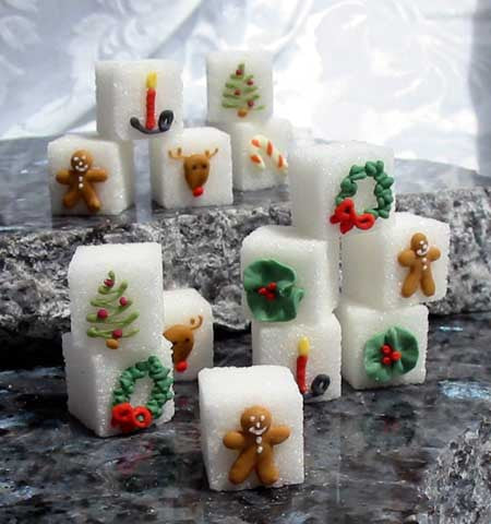 Decorated sugar cubes with Christmas wreaths, trees, candles, and gingerbread men