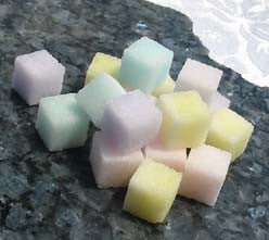 Sugar cubes in pastel shades of purple, pink, yellow, blue, and green