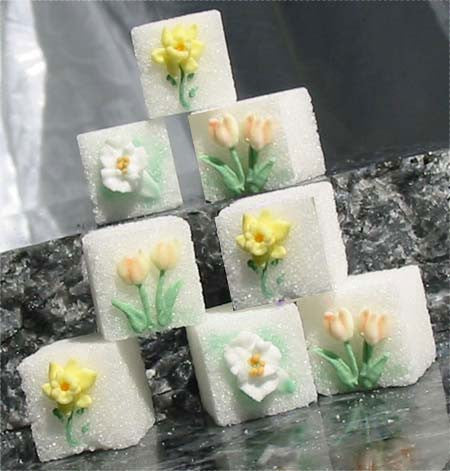 Decorated sugar cubes with liles, tulips, and daffodils