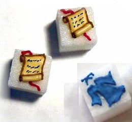 Decorated sugar cubes including graduation gowns and diplomas