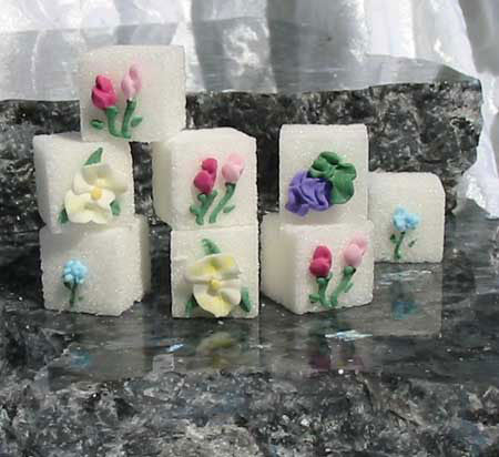 Decorated sugar cubes with yellow, blue, and pink flowers