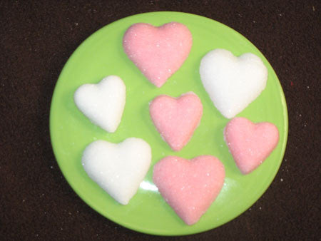 Tea sugars shaped in two sizes of pink and white hearts