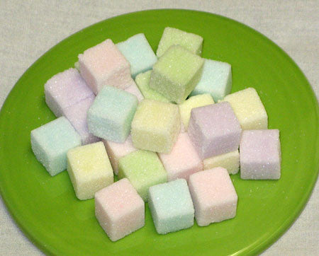 Mini-sized sugar cubes in pastel colors of green, blue, purple, pink, and yellow