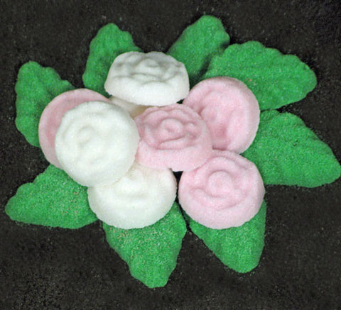Tea sugars shaped like pink and white roses and green leaves