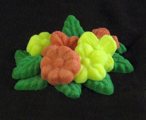 Tea sugars shaped like coral and yellow flowers and green leaves