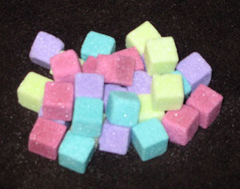 Mini-sized sugar cubes in fuchsia, lime, purple, and turquoise
