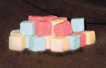 Mini-sized sugar cubes in red, green, and gold