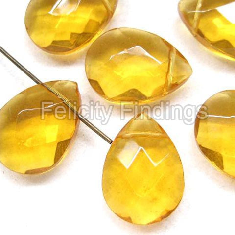 Faceted flat drop glass beads