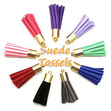 Suede tassels with gold-plated metal cap