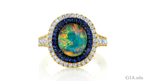 Omi Prive Opal ring with sapphires and diamonds in 18k yellow gold