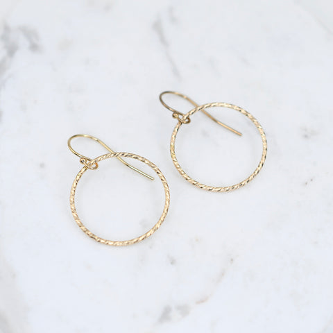 14K gold circle earrings.