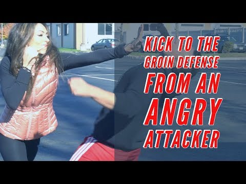 Kick to the groin defense from an angry attacker.