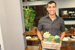 Man with succulent arrangement at succulent workshop in orange county