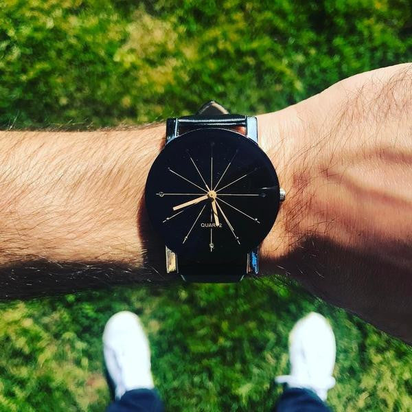 man wearing lincoln watch on his wrist
