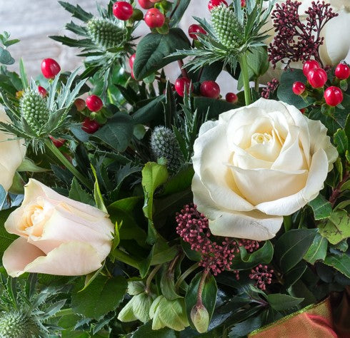 Winter White Roses with mixed seasonal foliage and berries (vase included)