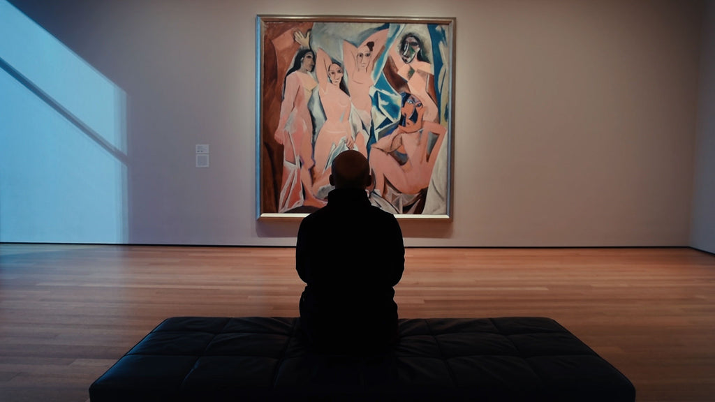 pablo cavides contemplating pablo picaso painting at museum of modern art in nyc