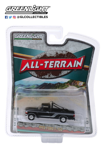 Greenlight 1:64 All-Terrain Series 9 - 1992 Ford F-150 4x4 - Raven Black with Silver Stripes