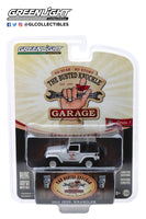 "Greenlight 1:64 Busted Knuckle Garage Series 1 : 2012 Jeep Wrangler ""Off Road Adventures"""