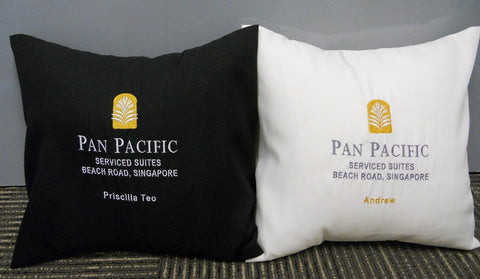 2 cushions with company logo