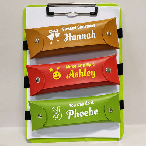 Book band pencil case in yellow, red and green