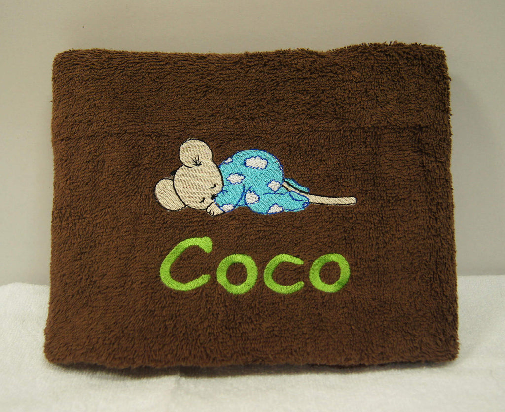 Dark brown towel with embroidery of name