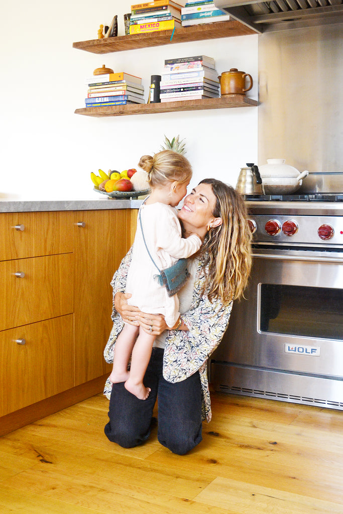 Meredith Baird with her daughter in their Los Angeles Home
