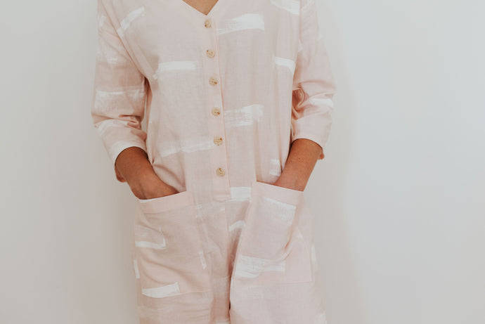 Our first hand-painted jumpsuit. Baby pink.