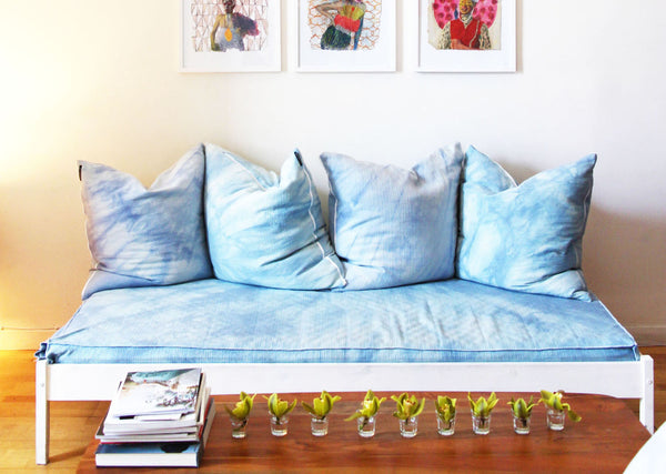 couch with tie dye pillows