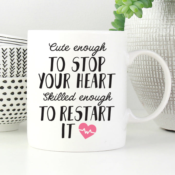 Cute enough to stop your heart, skilled enough to restart it mug