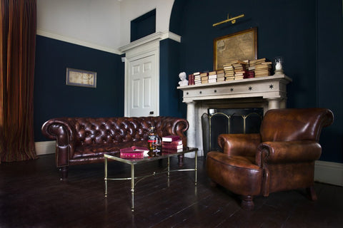 room showing two elegant chesterfield sofas