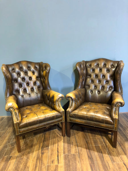 A Super Matching Pair of Vintage Leather Chesterfield Wing Back Chairs