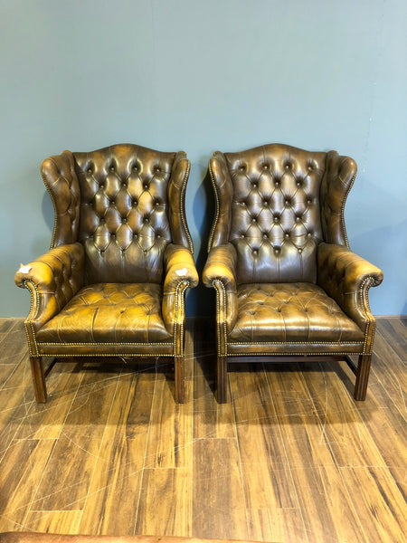 Vintage wing back chairs in Tobacco browns