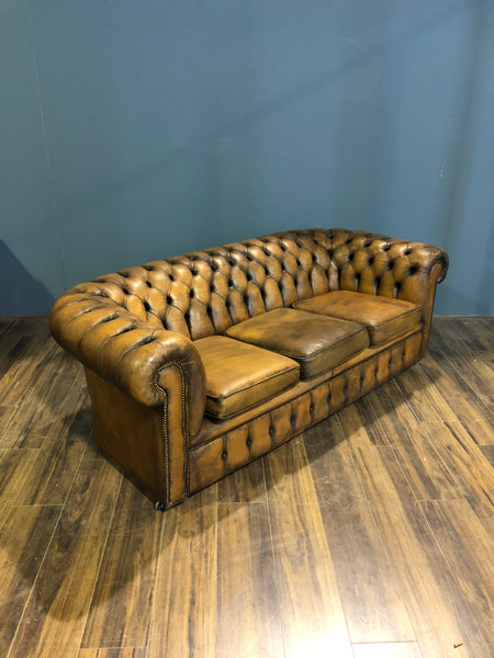 A Very Very Cool Matching Pair of Vintage Leather Chesterfield Sofas in a rustic Golden Tan