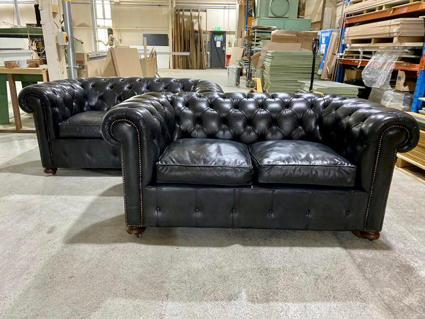 An Incredible Pair of MidC Hand Dyed Leather Chesterfield Sofas
