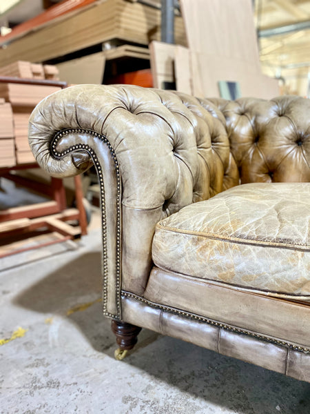 A very Smart 20thC Chesterfield Sofa in very Well Patinated Hand Dyed Leathers