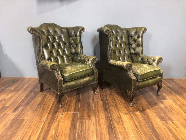 A Character-full Matching Pair of Rich Green Wing Back Chesterfield Chairs