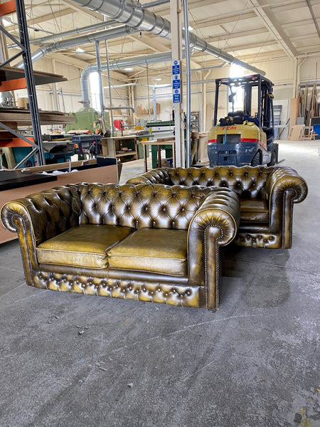 A Very Cool Pair of 2 seat Chesterfield Sofas in Autumn Tans