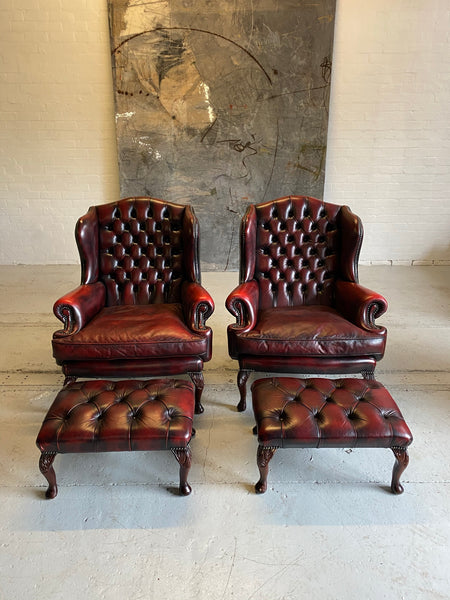 Exceptional Pair of Wing Back Chairs in Wine Reds & Matching Footstools