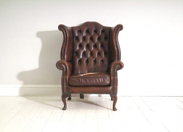 PAIR OF BROWN WING BACK CHAIRS : TO BE RESTORED