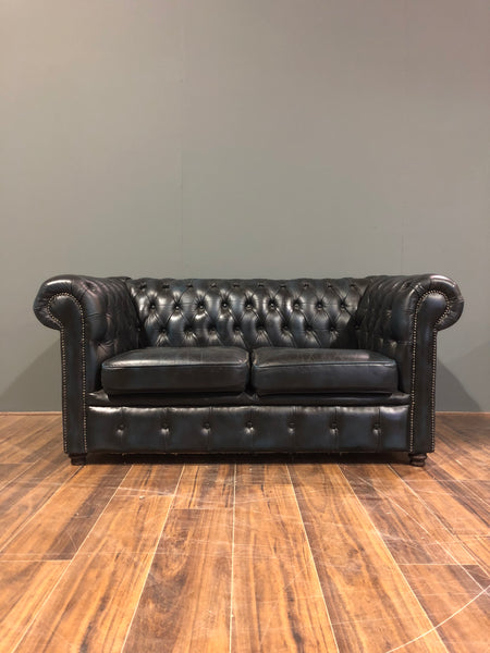 A lovely little 2 Seater Leather Sofa in Navy Blue