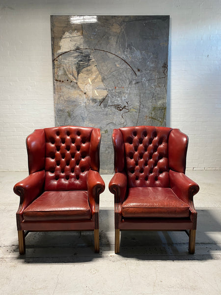 A Very Good Matching Pair of MidC Gentleman's Wing Chairs in Raspberry Leather