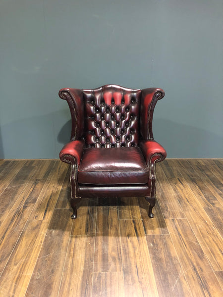 A Very Elegant Leather Chesterfield Wing Back Chair