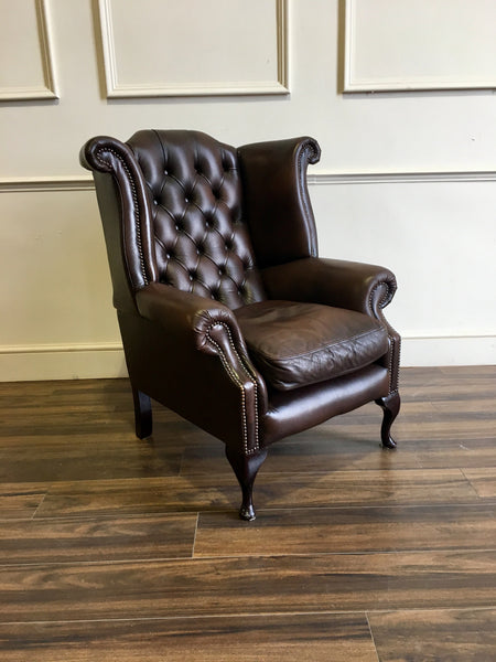 A Beautiful Leather Chesterfield Wing Back Chair in Rich Chocolate