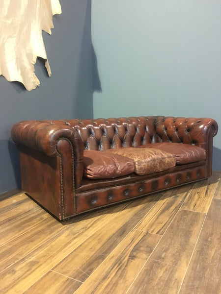 A Rustic Burnt Red Sofa with Great Character