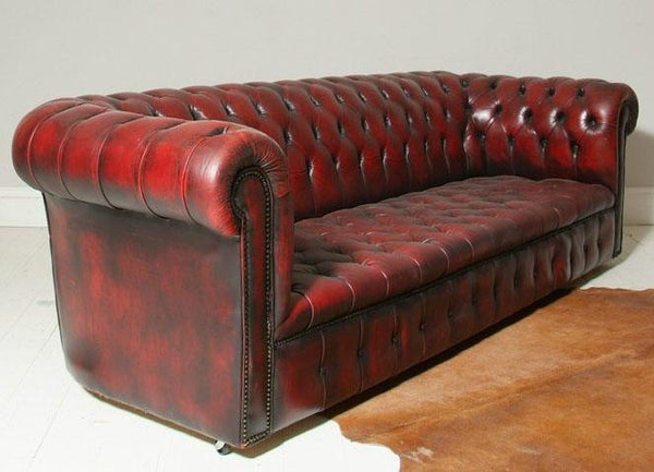 FULLY BUTTONED FOUR SEATER OXBLOOD CHESTERFIELD SOFA