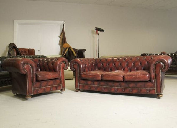 EXCEPTIONAL OXBLOOD COIL SPRUNG SOFA